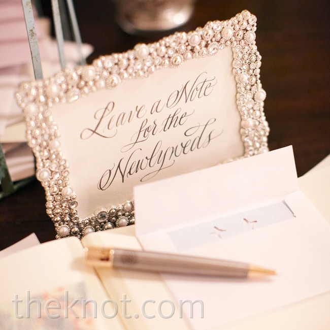 An embellished frame prompted guests to leave notes for the couple.