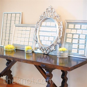 Simple escort cards were displayed in elegant metallic frames.