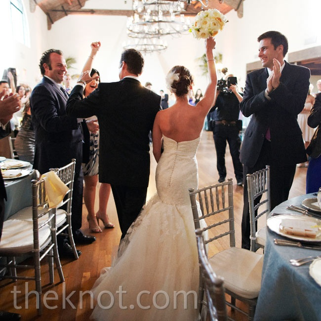 "The couple made quite the entrance at their reception: They wanted in to ""Raise Your Glass"" by Pink."