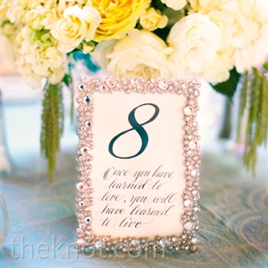 Glam silver frames drew attention to the table numbers, which each featured a quote related to love.