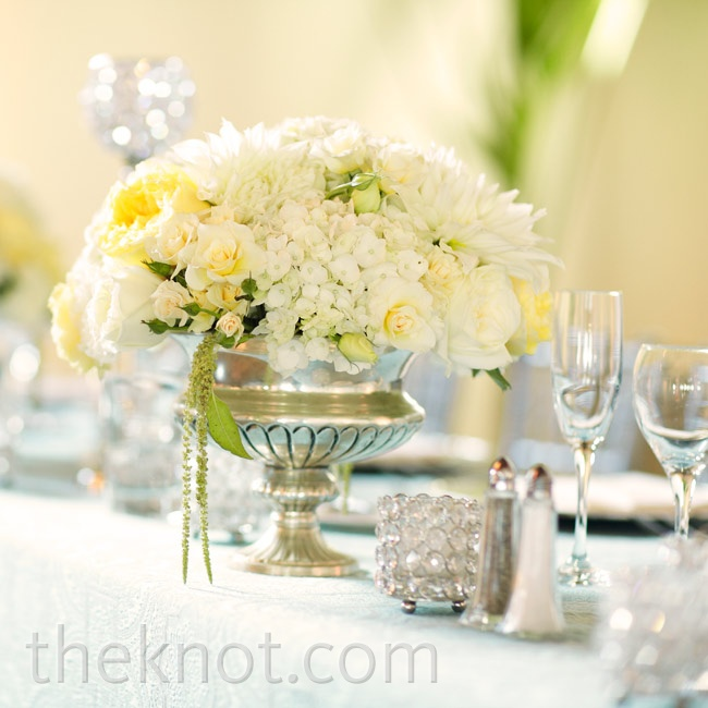 Silver urns (filled with round arrangements of spray roses, dahlias, lisianthus, and green amaranthus) topped some of the tables.