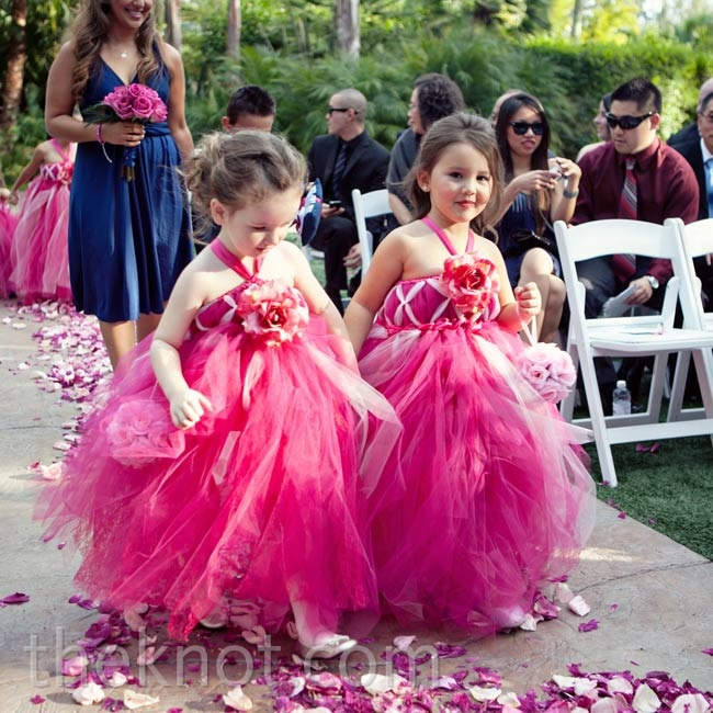 The four flower girls wore fuchsia tulle dresses and carried pink rose pomanders down the aisle.