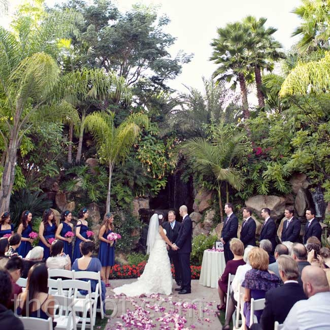 The ceremony, staged in front of a waterfall  and lush vegetation, needed few decor additions.