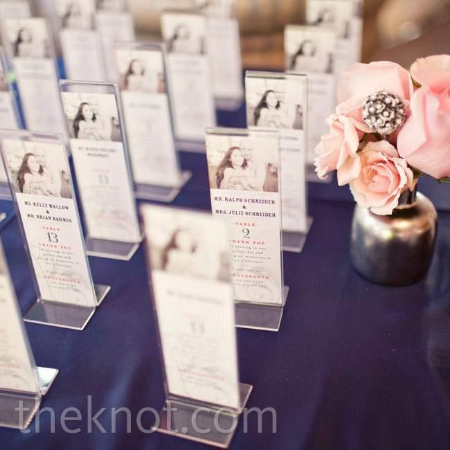 Acrylic frames with an engagement picture of the couple served as escort cards that guests could later fill with photo booth pics.