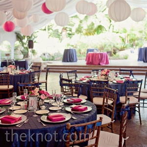 Navy pintuck linens topped the dinner tables, while pink and white Chinese lanterns hung from the ceiling.