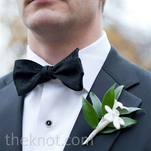Scott and his groomsmen looked sharp in classic black tuxedos, bow ties and stephanotis boutonnieres.