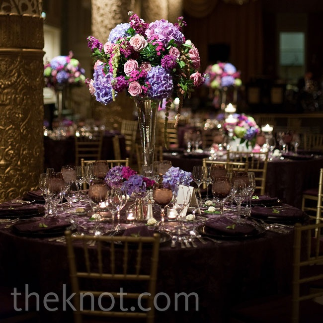 Tall, beveled-glass trumpet vases topped with antique hydrangeas, roses, stock, lisianthus, sweet Williams and eucalyptus in a mix of lavender, green and magenta were surrounded by smaller groupings of coordinating blooms.