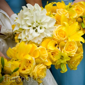 Inspired by a bouquet of white calla lilies surrounded by yellow roses that she saw on TheKnot.com, Kelley chose a bouquet of all-white calla lilies for herself and monochromatic bunches of yellow roses, tulips, ranunculus and calla lilies for her bridesmaids.