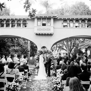 The couple wed in front of a koi pond and wrought-iron arbor.