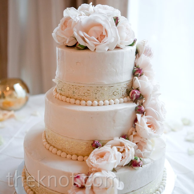 Cascading roses and lace trim adorned the three-tiered cake.