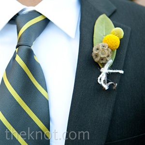 The groomsmen wore yellow and gray ties with yellow boutonnieres to match.