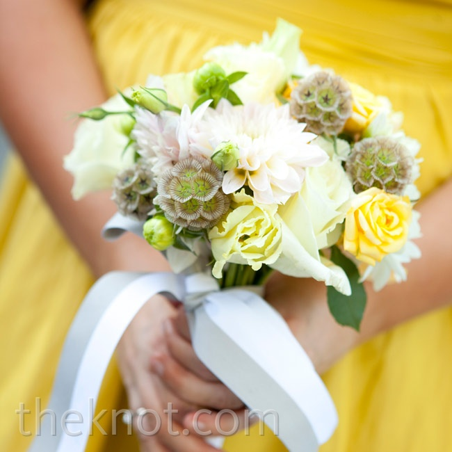 The bridesmaids carried petite bouquets of scabiosa pods and soft-yellow roses.