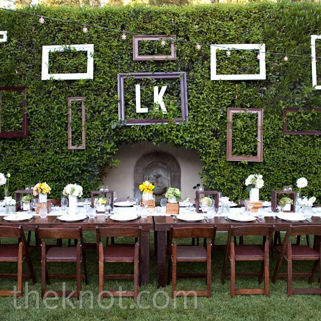 A mural of frames served as the focal point behind the long wooden head table.