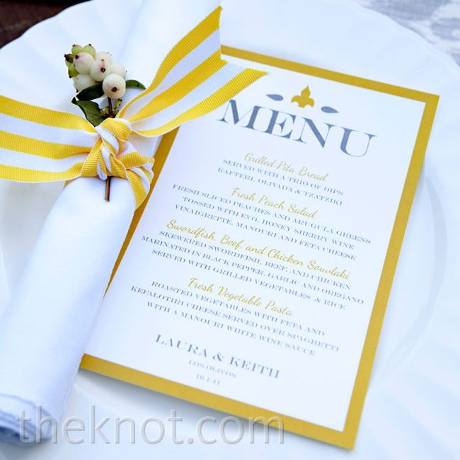 Yellow menu cards and napkin ties popped against ikat linens.