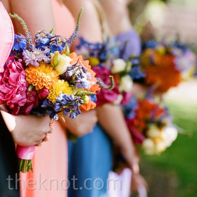 The bridesmaids carried vibrant bunches of mixed flowers.