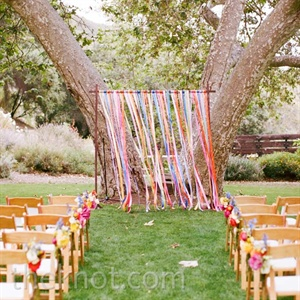 The altar was decorated with various ribbons in the multicolored palette.