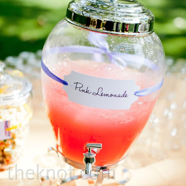 Thinking ahead for the hot summer day, the couple put pink lemonade and snacks out for guests during the ceremony.