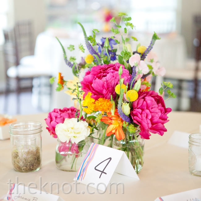 Mason jars filled with bright peonies, sweet peas, billy balls, and delphiniums gave a fresh-picked vibe.