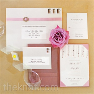 The invitation suite's elegant pink-and-white design and feminine packaging foreshadowed the day's romantic vibe.
