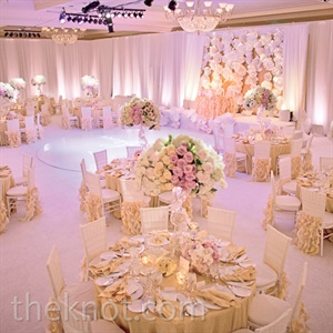 Tables draped in yellow linens and chairs with coordinating ruffled covers surrounded the high-gloss dance floor.