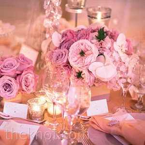Dramatic centerpieces of roses, hydrangeas, phalaenopsis orchids and peonies completed the über-elegant look.
