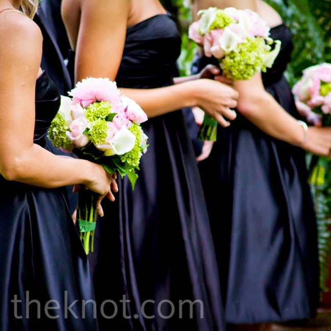 The girls' arrangements of peonies, hydrangeas, calla lilies and roses complemented their classic black-satin dresses.