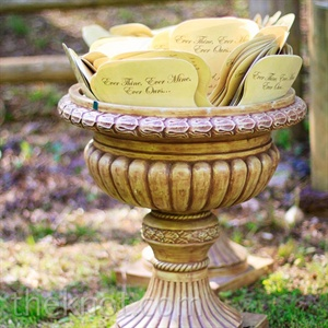 Jason's design company printed the programs, which were placed in antique-style urns at the ceremony entrance.