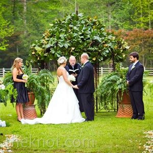 Chelsey and Jason exchanged vows standing before a large magnolia-and-grapevine gazebo, framed by flowing ferns.