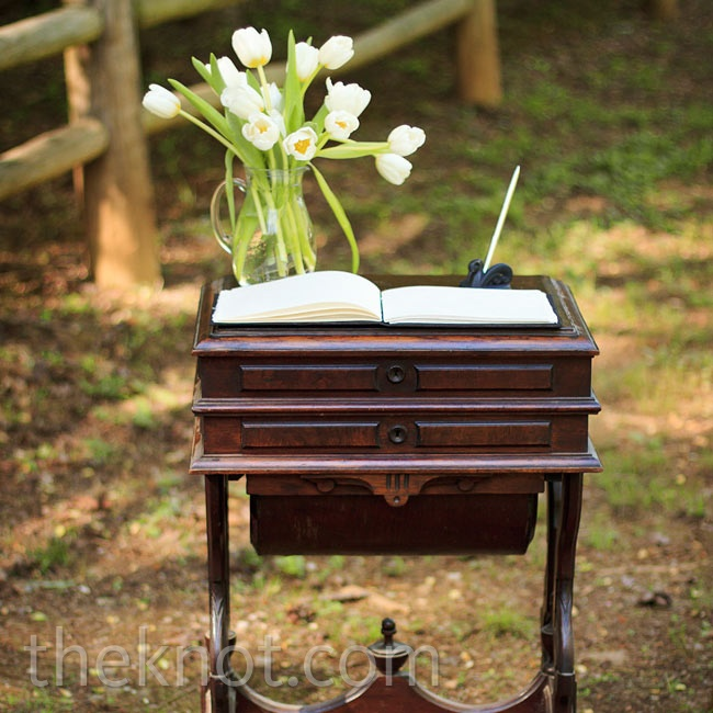 Aiming for a vintage-inspired look, the couple incorporated antique furniture into their ceremony and reception.