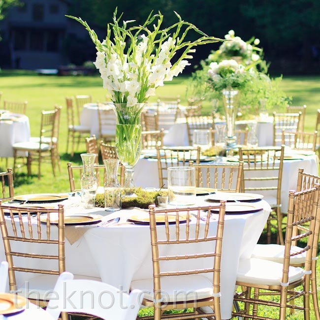 Each table was topped with crisp white linens and burlap, and was finished with a unique floral centerpiece.