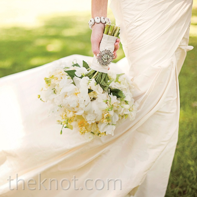 Paige's all-white bouquet was accented with a brooch from her grandmother's own collection.