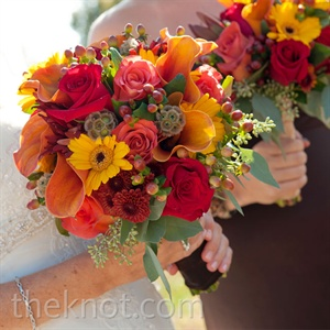 Elyse's seasonal bouquet included spider mums, sunflowers, hypericum berries, eucalyptus, and Leonidas roses, along with a fresh hint of greenery.