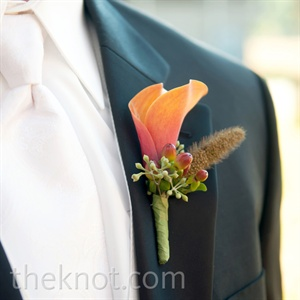 Kyle's boutonniere was an orange calla lily accented with red hypericum berries and a cattail.