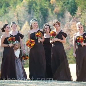 Off-shoulder draping added a fashionable surprise to the classic bridesmaid dresses.