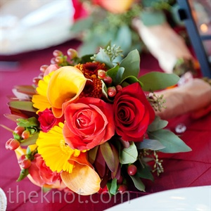 Bouquets from the ceremony indicated which reception tables were reserved for the bridal party.