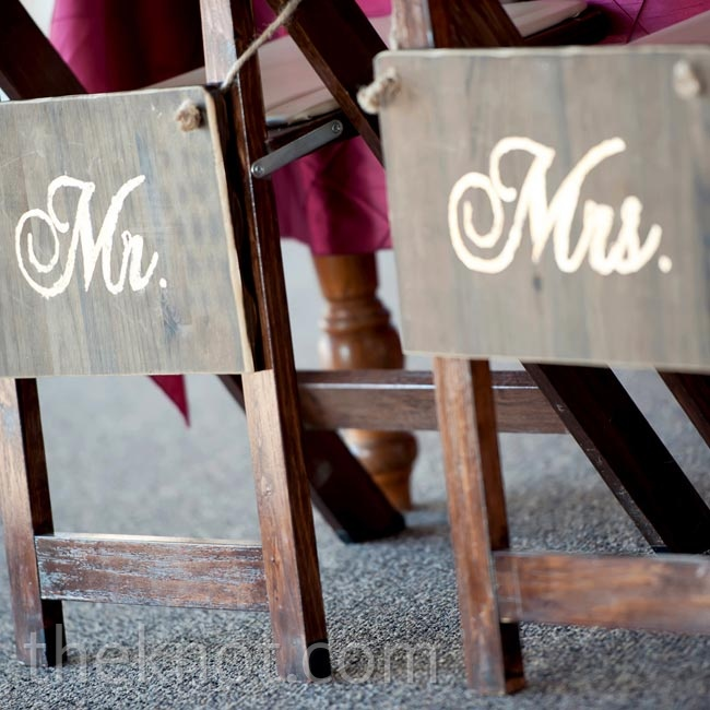 Elyse's sister Lauren refinished cabinet doors into gold-leafed signs for the couple's reception chairs.