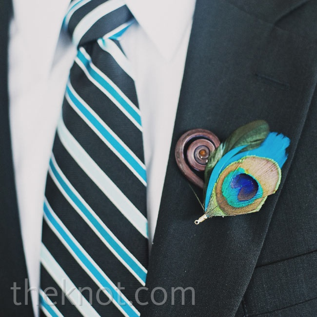 Eric wore a boutonniere of a tightly curled fiddlehead fern with peacock feathers.