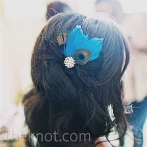 Lisa found this feather hairpiece on Etsy.com and used it as inspiration for the wedding day decor.