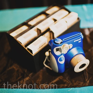 A Polaroid-camera guest book was one of many interactive details in the fun-filled soiree.