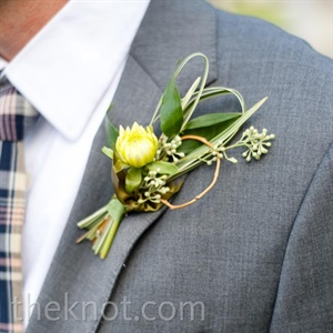 A single yellow dahlia was a soft touch to the sculpture-like boutonnieres.