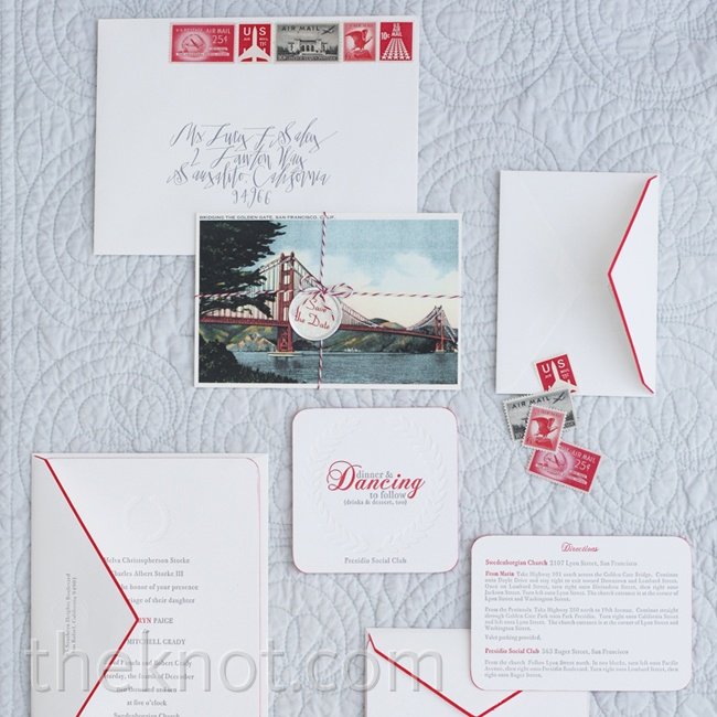 Thick white paper with red hand-painted edges and vintage stamps gave the stationery a retro feel.