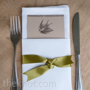 Each menu card was folded in a white linen napkin and laid atop burlap tablecloths. A chartreuse satin ribbon finished the look.
