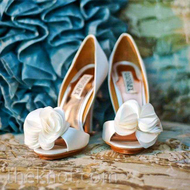 Allison wanted an all-around classic look, so she opted for these white peep-toe pumps with a simple floral embellishment.