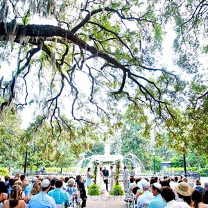 Sprawling oak trees framed the couple as they exchanged vows in front of the iconic fountain Forsyth Park.
