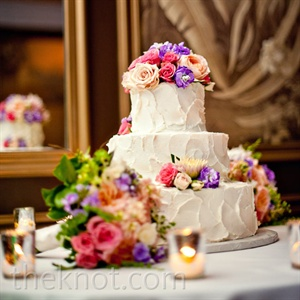 Fresh flowers topped the three-tiered buttercream-frosted pound cake.