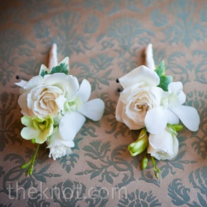 The men wore cream roses with double dendrobium orchid accents wrapped in satin and gold wire.