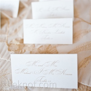 The off-white tented cards with gold calligraphy matched the menus.