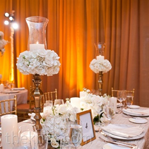Creamy-white blooms set on gold candelabras and ivory candle pillars created a soft, intimate feel.
