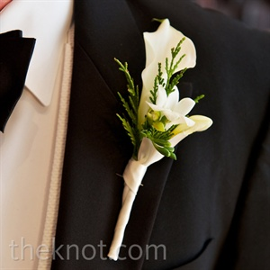 Evergreen accents gave Colby's white boutonniere a masculine feel.