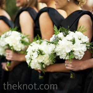 The bridesmaids held ivory bouquets made up of roses, hydrangeas and spiky winter greens.